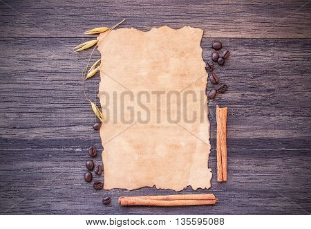 Old paper and coffee beans on dark wooden table background. top view with copy space