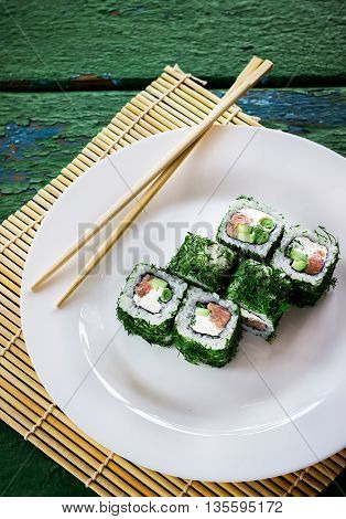 Rolls On White Plate. Rolls On White Plate. Old Green Wooden Background.