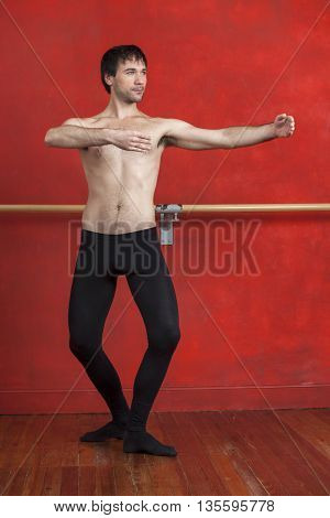 Male Dancer Practicing In Ballet Studio
