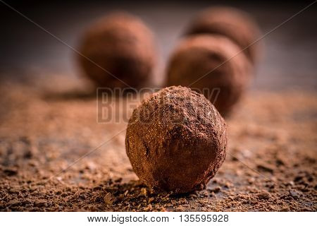 Homemade chocolate truffles on wooden background, studio shot