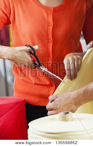Tailors Cutting Fabric In Sewing Factory