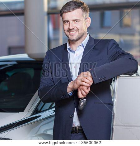 Happy car dealership client at car service