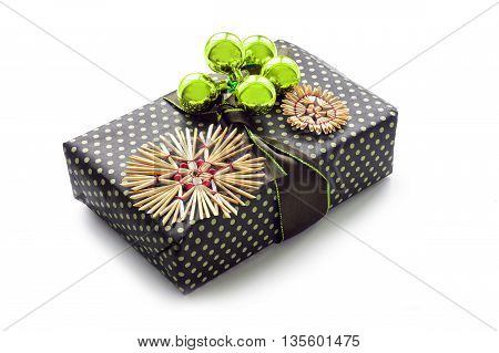 christmas present with decoration from straw stars and golden baubles isolated with shadows on a white background