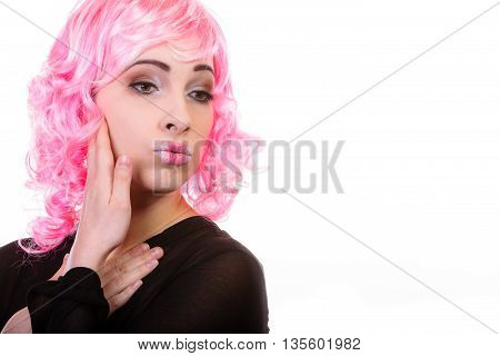 Portrait woman with pink wig creative visage makeup isolated on white background