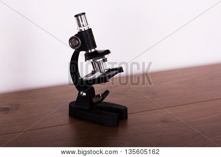 Microscope On A Table For Science Background
