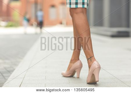 legs of a beautiful girl in high heels. Toned image