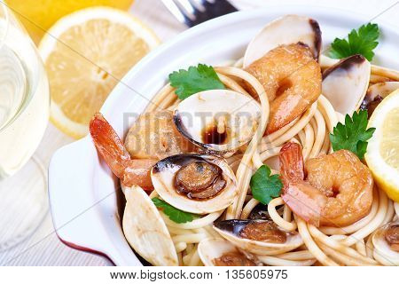 Spaghetti with prawns and clams. Seafood meal