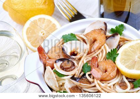 Spaghetti with fresh clams and herbs. Seafood meal