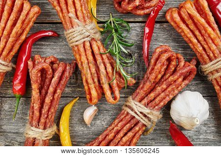 Snack stick sausages on a wooden table