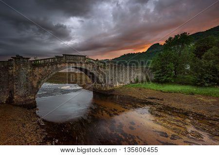Garron Bridge on Gearr-Abhainn river in sunset light Highlands Scotland