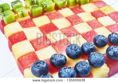 Fun food. Checkers made from fruits. Food for kids