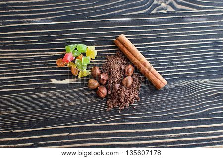 Nuts, cinnamon, candied fruits, chocolate chips lie on the texture table