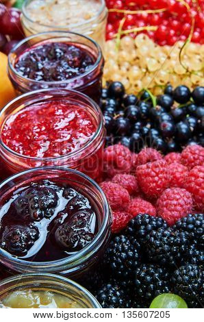 Mix of jams and fruits. Colorful jams