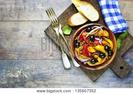 Peperonata - traditional dish of italian cuisine in a wooden bowl.Rustic style.
