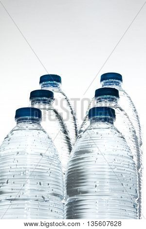 fresh mineral water in plastic bottles with free space for text