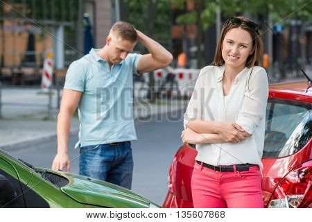 Wounded Woman Standing At Roadside While Man Getting Worried After Car Accident