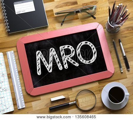Small Chalkboard with MRO Concept. Business Concept - MRO Handwritten on Red Small Chalkboard. Top View Composition with Chalkboard and Office Supplies on Office Desk. 3d Rendering.