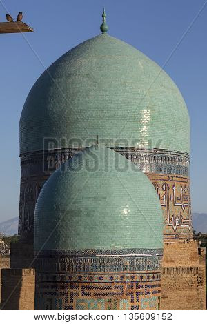 The green domes of a mosque in Samarkand, Uzbekistan.