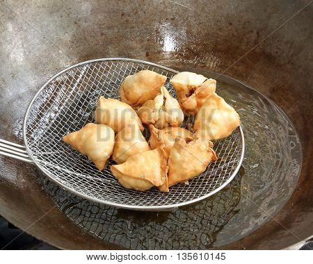 Frying cooking preparing samosa singara stuffed with vegetable potato meat