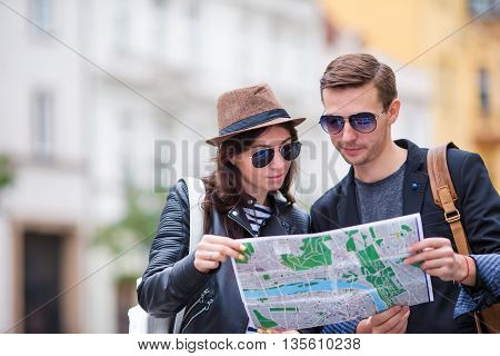 Happy tourist couple, man and woman traveling on holidays in Europe smiling happy. Caucasian couple.