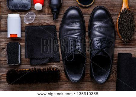 Shoe wax, brush and boot