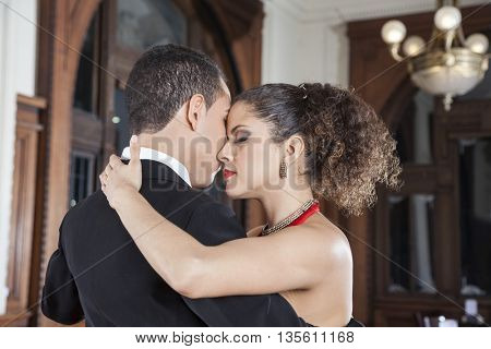 Woman And Man Touching Foreheads While Performing Tango
