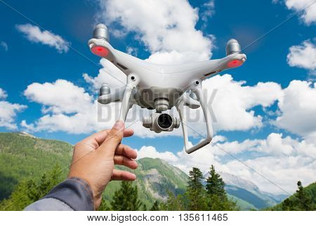 Hovering drone on the blue sky background