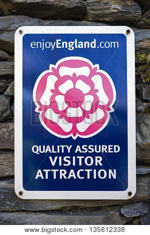 CUMBRIA UK - MAY 29TH 2016: An Enjoy England recommended and Quality Assurance sign at a visitor attraction in the Lake District National Park on 29th May 2016.