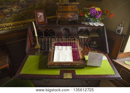 CUMBRIA UK - MAY 30TH 2016: Beatrix Potters writing desk at Hill Top - a 17th Century House once home to childrens author Beatrix Potter taken on 30th May 2016.