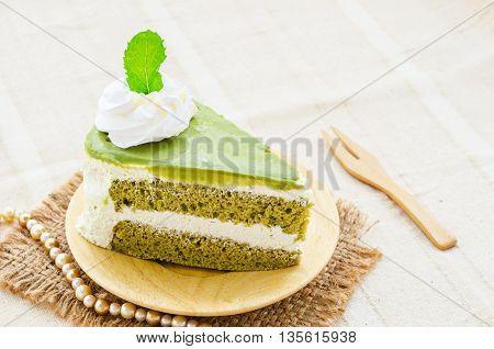 Japanese Matcha Green tea cake on tablecloth.