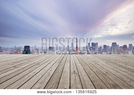 skyline and cityscape of tokyo in romance sky on view from empty wooden street