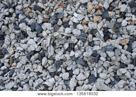 Gravel stone texture. Little round stones in different colors. Background image.
