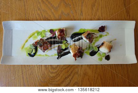 Grilled octopus dish served in gourmet restaurant