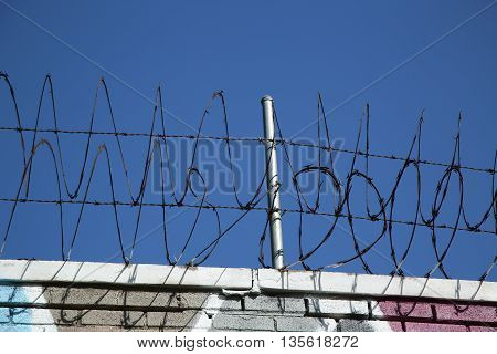 Barber wire fence on a sky background