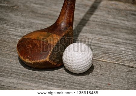 An old wood driver and golf ball bring back memories.