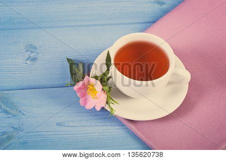 Vintage Photo, Cup Of Tea And Wild Rose Flower On Blue Boards, Copy Space For Text
