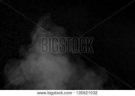 Abstract white water vapor on a black background. Texture. Design elements. Abstract art. Steam the humidifier. Macro shot.