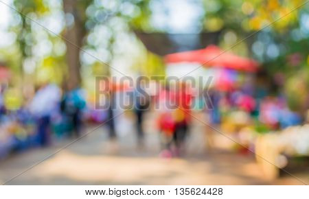Blurred Image Of People Walking At Day Market