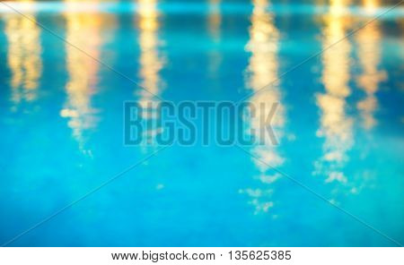 blue water in swiming pool with light in summer