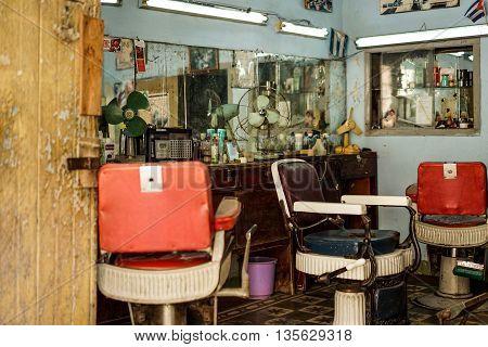 Santiago De Cuba Cuba - January 10 2016: Old barber shop in the old quarter a popular and busy tourist destination in Cubas 2. largest city.
