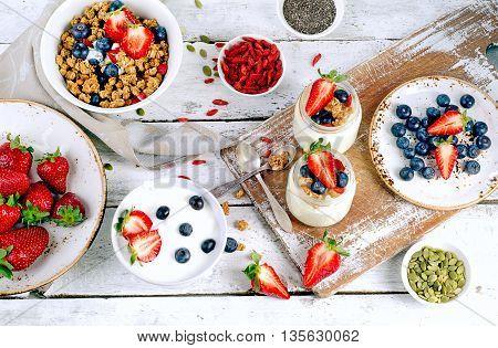 Yogurt, Muesli, Fresh Berries, Goji And Chia Seeds For Healthy Diet Breakfast