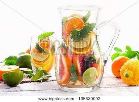 Pitcher And Glass With Citrus Fruits