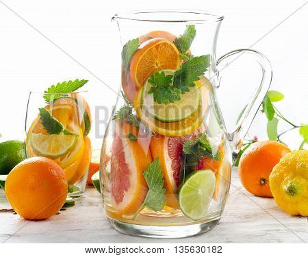 Pitcher With Citrus Fruits And Mint Leaves.