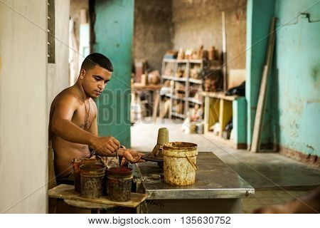 Trinidad Cuba - January 14 2016: Potter House or Casa del Alfarero run by Daniel Chichi Santander. Trinidad has a proud tradition of pottery and a local potter shows his craft and work