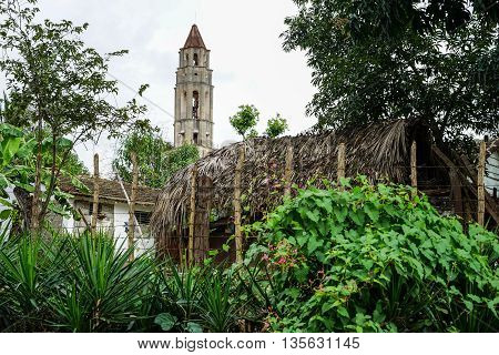Valle de los Ingenios Trinidad Cuba - January 14 2016: Slave Tower Manaca Iznaga which is preserved from Cuba's past when slavery was legal. The tower is located in the Valle de los Ingenios and is today a major tourist attraction