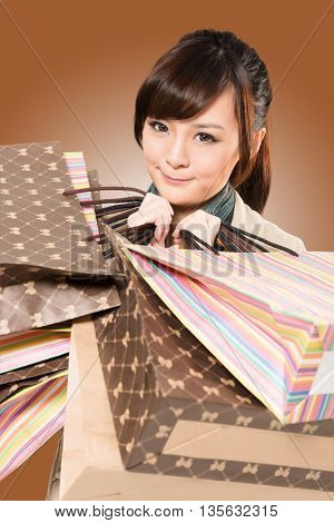 Asian woman shopping, closeup portrait with bags