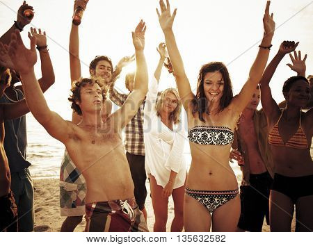 Group of people enjoying a summer beach party Concept