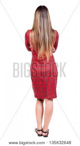 back view of standing young beautiful  woman. girl Watching. Rear view people collection.  backside view of person.  Isolated over white background. girl in red plaid dress put her hands on his chest.