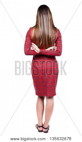 back view of standing young beautiful  woman. Rear view people collection.  backside view of person.  Isolated over white background. The girl in red plaid dress put her hands behind her back.