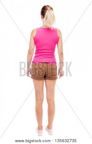 back view of standing young beautiful  woman.  girl  watching. Rear view people collection.  backside view of person.  Isolated over white background. The girl in brown shorts and a pink shirt posing.